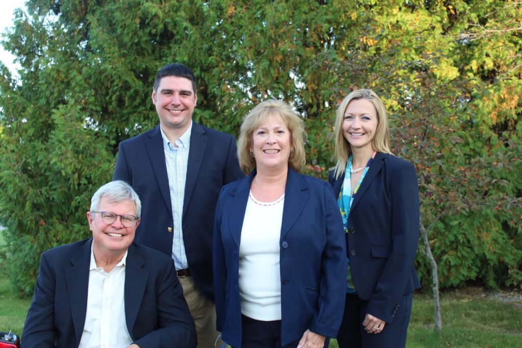Chelsea State Bank Team -- From left, CEO John Mann, Commercial Lender Stu Mann, Executive Vice President, Mary Lee Penny and President Joanne Rau.